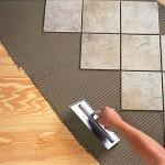 Укладка плитки на деревянный пол: как правильно это сделать?